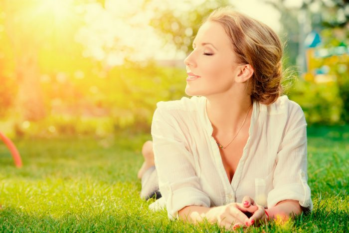 bigstock-Beautiful-smiling-woman-lying--73499776