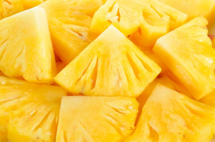 bigstock-Close-Up-Slice-Pineapple-Backg-93937523