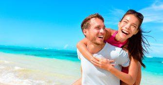 bigstock-Happy-couple-in-love-on-beach--85188443