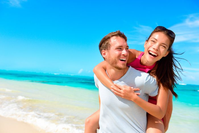 bigstock-Happy-couple-in-love-on-beach--85188443