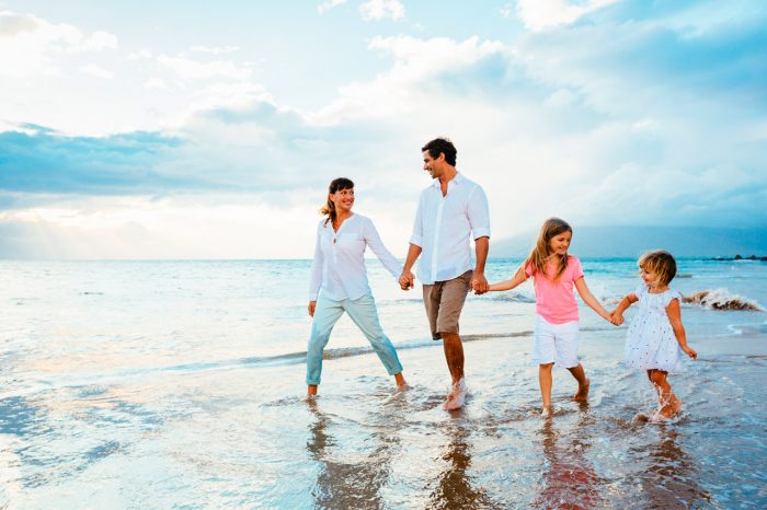 bigstock-Happy-young-family-walking-on--63095971