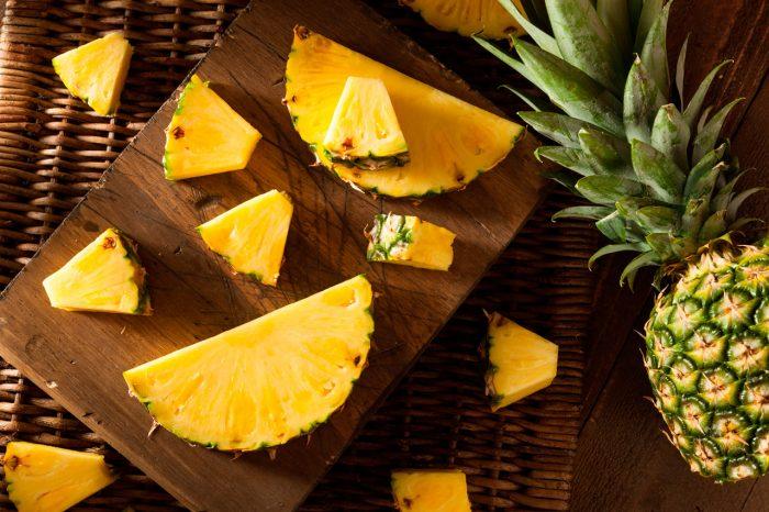 bigstock-Organic-Raw-Yellow-Pineapple-91920494