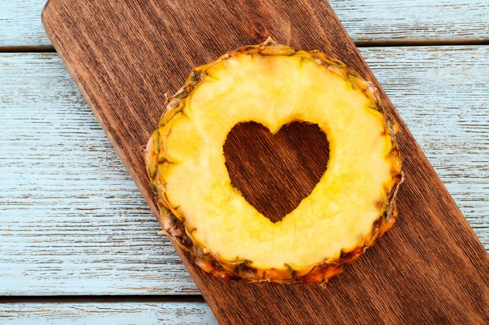 bigstock-Pineapple-slice-with-cut-in-sh-103788080