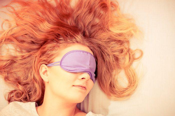 bigstock-Sleeping-Woman-Wearing-Blindfo-106832498
