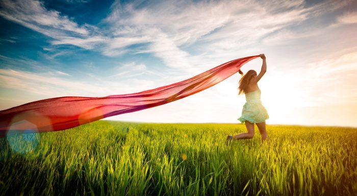 bigstock-Young-happy-woman-in-wheat-fie-87102695