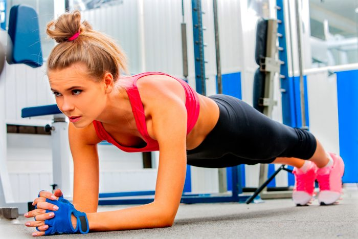 bigstock-Young-woman-doing-some-push-up-106753763