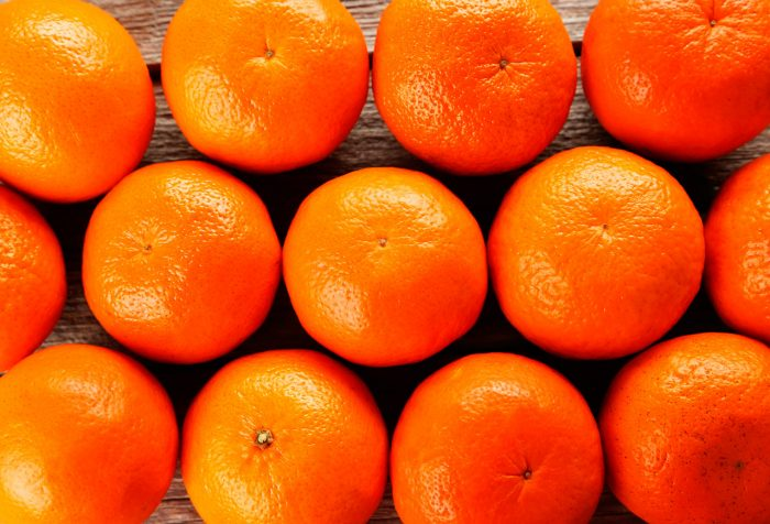 bigstock-fresh-and-tasty-Mandarin-backg-98193548