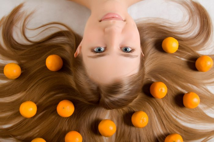 bigstock-young-girl-tangerine-orange-12225275