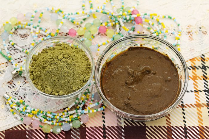 Henna powder. Henna paste. Henna prepared for cosmetic procedures. Still life with henna and beads.