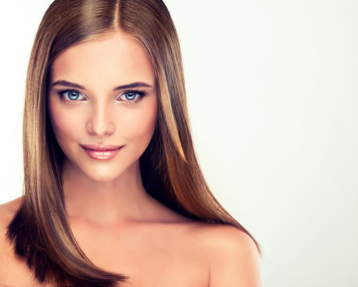Beautiful girl with brown hair . Long straight hair Shine with h