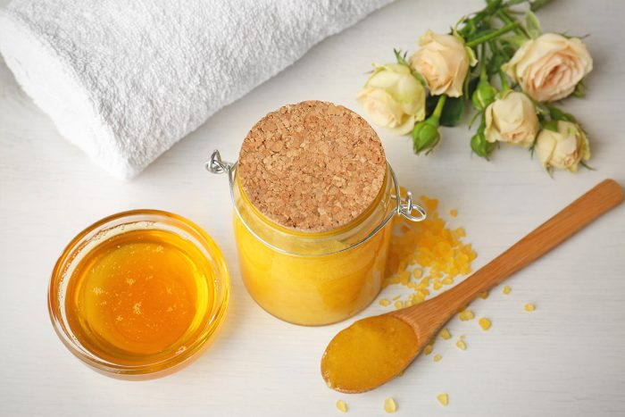 Spa concept. Natural facial mask with honey, towel and flowers o