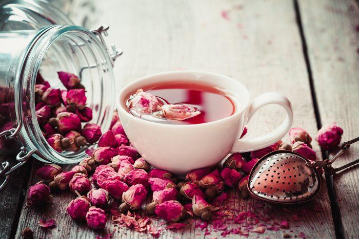 Rose Buds Tea, Tea Cup, Strainer And Glass Jar With Rosebuds. Se