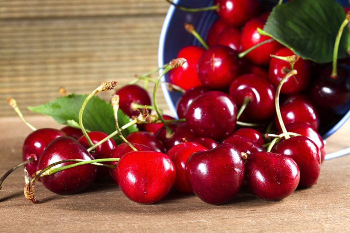 Fresh sweet cherries on the table boards