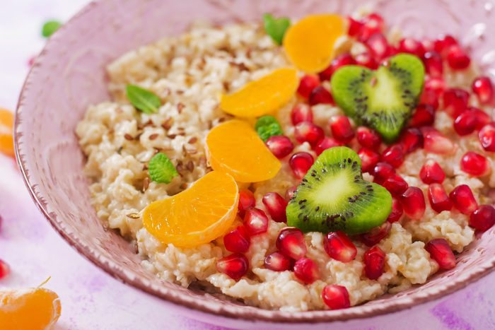 Tasty And Healthy Oatmeal Porridge With Fruit, Berry And Flax Se